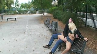 Horny couple fucking on public bench