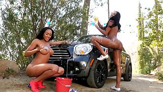 Ebony dolls posing naked in superb car wash nude scene
