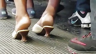 Candid ebony heels on the bus