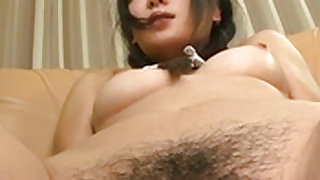 Hot babe with hairy pussy moans as she gets rubbed in her privates