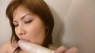 Another brunette sweetie from the East is worshiping the penis