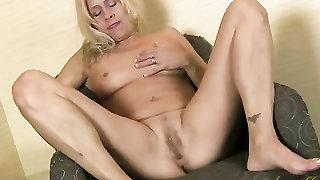 Masturbating mature slut has a sexy clit ring